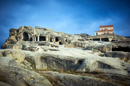 Uplistsikhe. Ancient rock cave city complex with christian basilica church in Georgia