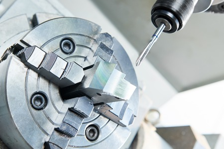 metal working: metalworking industry. Thread making by cutting screw tap on modern cnc metal working machining center