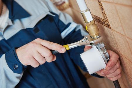 Plumber work. maintenance repairman worker installing gas meter counter