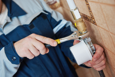 Plumber work. maintenance repairman worker installing gas meter counter Stock fotó - 65192956