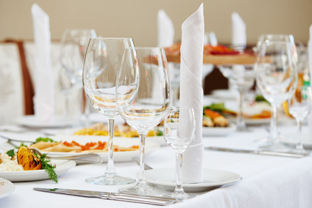 Catering services. Empty glasses set and food in restaurant Stock Photo