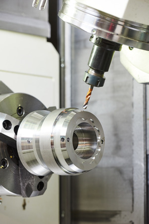 metal working: metalworking industry. drilling a hole on modern metal working machining center Stock Photo