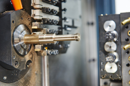 moderm: Metalworking industry. close-up view of brass detail during cutting process on moderm machining center Stock Photo