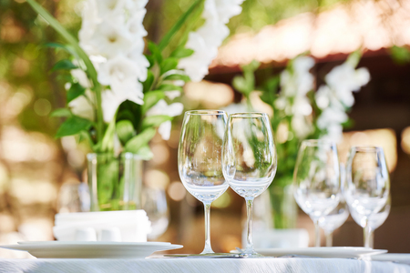 Catering services. glasses and plate table appointments in restaurant