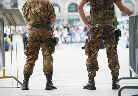 citizens: city safety and security. armed military police watching order in the urban street