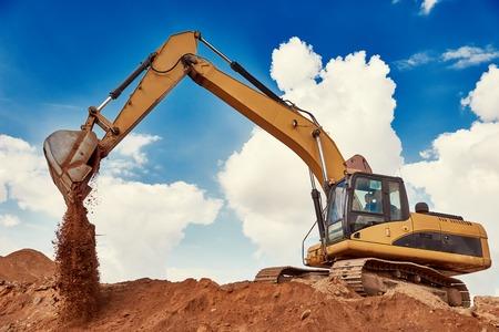 excavator machine loader digging or earthmoving during construction works at sand quarry