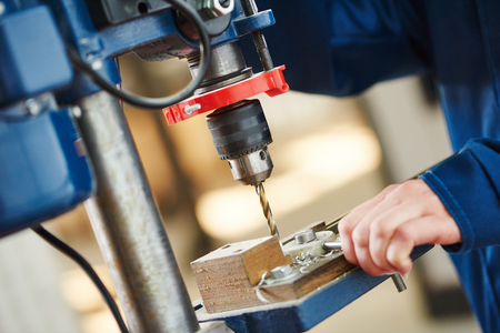 rapid steel: Manual driling machine operating by worker at metal cutting process boring a hole Stock Photo