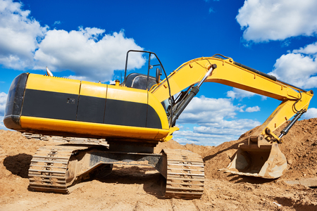 excavator machine loader during earthmoving construction works at sand quarry