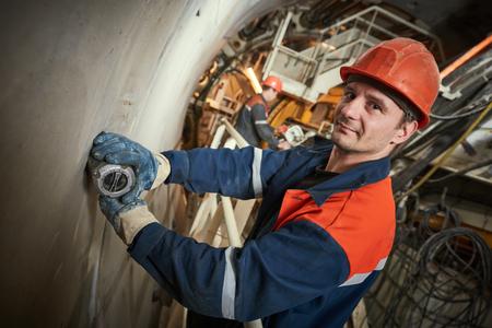 tunneling: underground railway builder at tunnel construction work
