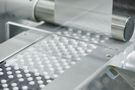 pharmaceutical medicine tablet pill production at pharmacy industry manufacture. blistering conveying system line