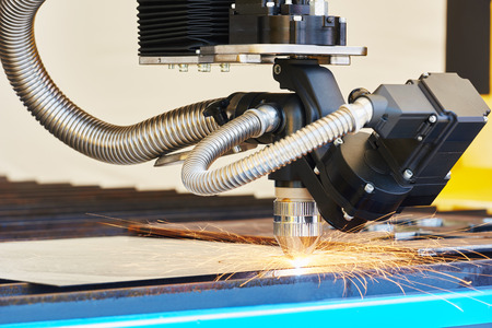 processing: plasma or laser cutting metalwork. Technology of flat sheet metal steel material processing with sparks