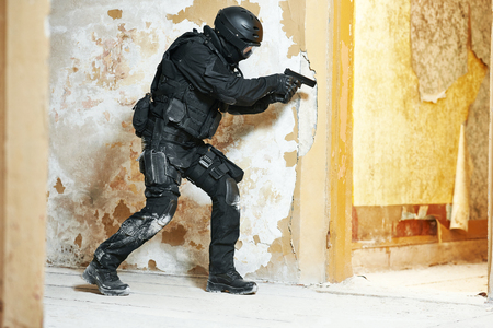 antiterrorist: Military industry. Special forces or anti-terrorist police soldier, private military contractor armed with pistol ready to attack during clean-up operation, mission