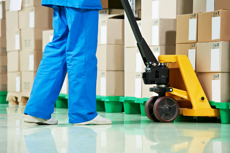 medical warehouse works by lifting stacking equipment and boxes with medcine drugs stack arrangement Stock Photo