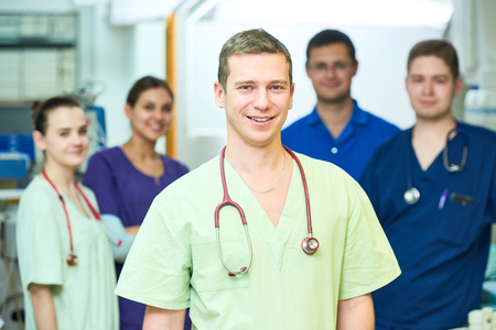 Hospital medic staff. Team of young surgeon doctors at operation room