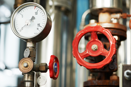 Closeup of manometer, pipes and faucet valves of heating system in a boiler room Stock Photo - 68064419