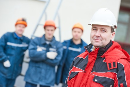 Technician builders workers team with supervising foreman