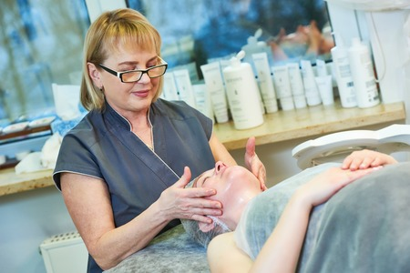 cosmetologist beautician with client in beauty salon