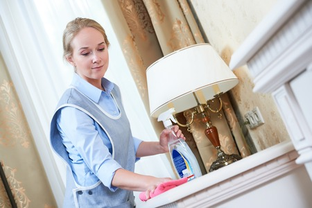 hotel staff: Cleaning service. hotel staff removing dust Stock Photo