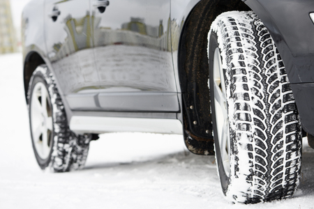 installed: Winter tyres wheels installed on suv car outdoors