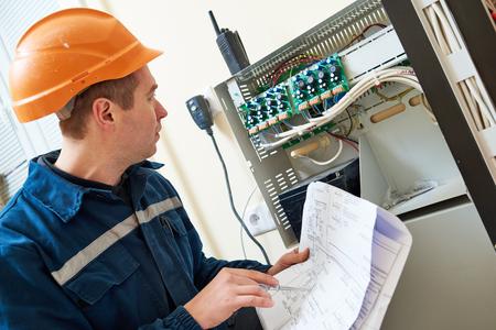 Electrician worker adjusting video surveillance system