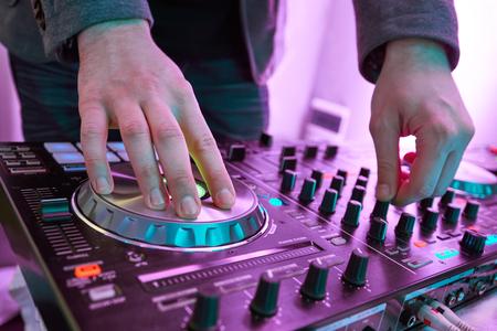 midi: DJ plays and mix music on digital midi mixer controller.