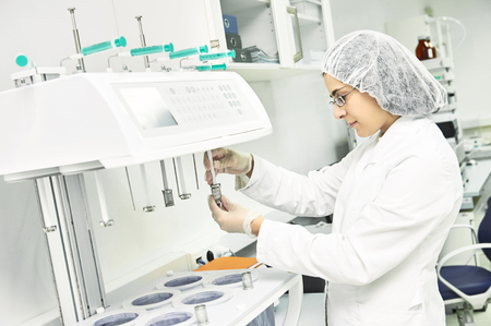 Pharmaceutical researcher making dissolution test