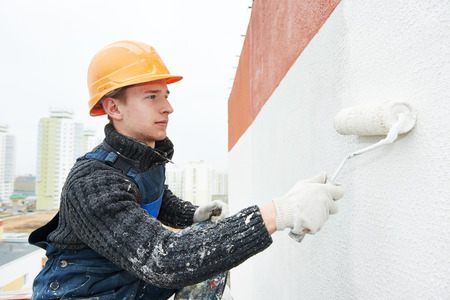 builder facade painter at work 스톡 콘텐츠
