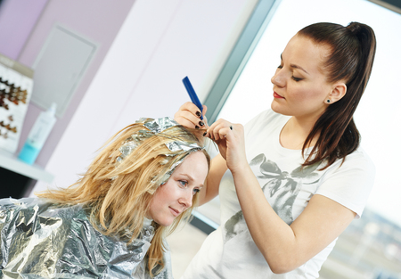 hair coloring: Highlight. woman hairdressing in salon
