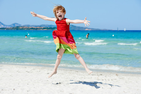 Exciting little girl at sea beach Stock Photo