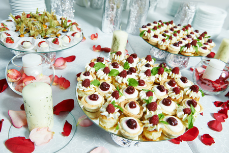 biscuits: strawberries with chocolate at catering party