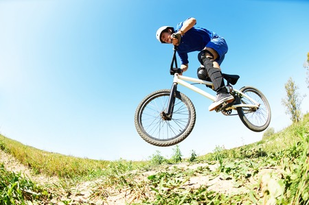 cyclist riding jumping with bicycle cross-country Archivio Fotografico