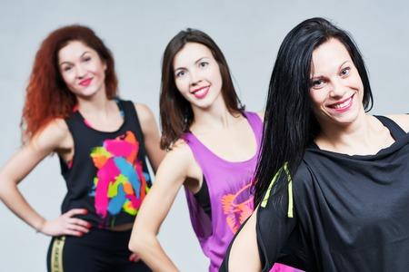 plasticity: fitness woman. smiling instructors group portrait