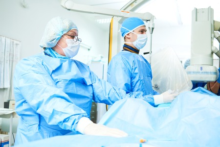 Interventional cardiology. Male surgeon doctor at operation 스톡 콘텐츠