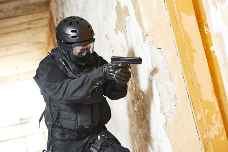 Anti-terrorist police soldier armed with pistol ready to attack Stock Photo