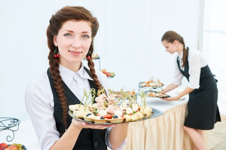 Waitress woman at restaurant catering event