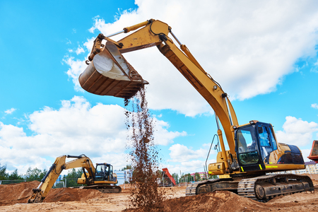 excavator at sandpit during earthmoving works Stock Photo - 70465074