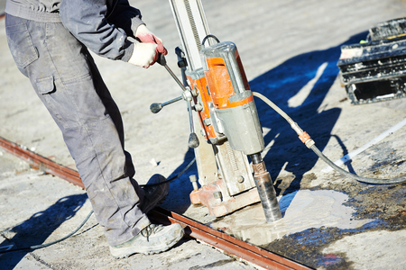 concrete floor: industrial concrete drilling at construction demolition work