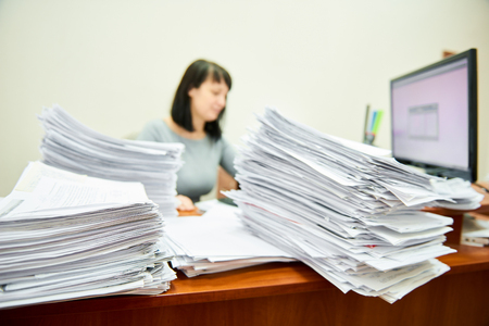 Female worker accountant with lots of paper documents Stock fotó