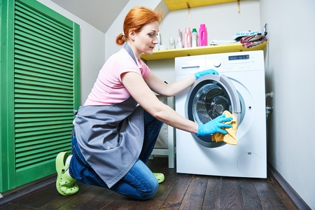 cleanse: Cleaning service. woman cleanse washing machine