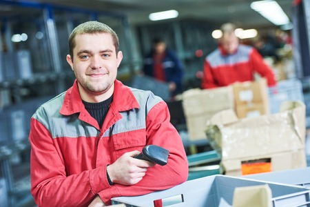 worker with barcode scanner at warehouse Stockfoto