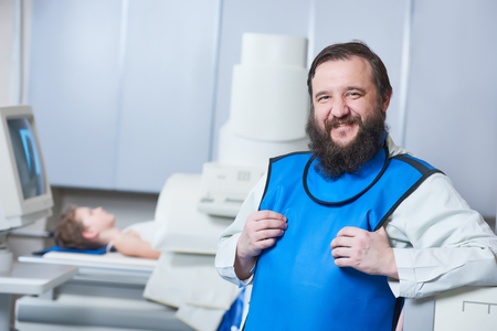 Radiology specialist portrait. Smiling male radiologist in protective wear