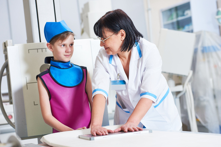 Nurse assistant with little boy preparing or x-ray radiography Stock Photo