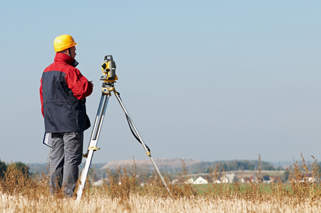 tachymeter: Geodesy. surveyor worker with theodolite