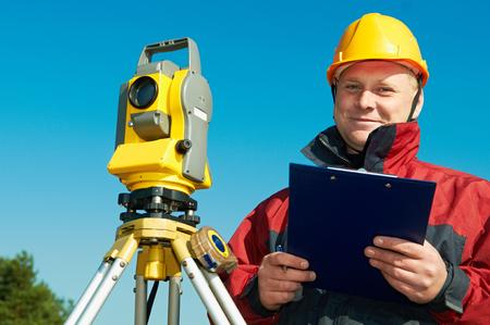 theodolite: surveyor worker with theodolite Stock Photo