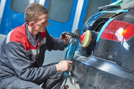 rennovation: auto mechanic buffing car autobody Stock Photo