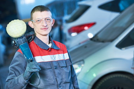 auto mechanic with buffing machine