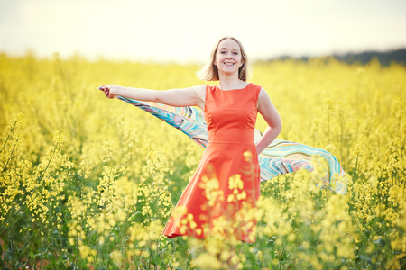 freedom: woman at yellow rape seed meadow