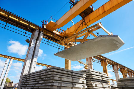Construction industrial worker operating hoisting process of concrete slab Stock Photo