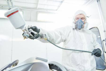 repairman painter in chamber painting automobile car bonnet Stok Fotoğraf