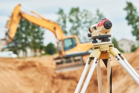 exact position: Surveyor equipment level outdoors at construction site Stock Photo